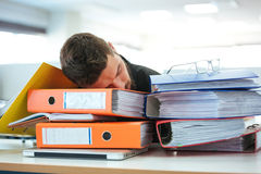 Businessman sleeping on the folders Stock Images