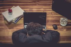 Businessman sleeping front Laptop computer stock images