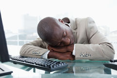 Businessman sleeping on his desk Stock Photo