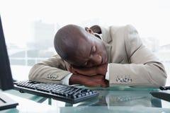 Businessman sleeping on his desk Stock Photo