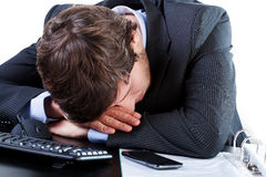 Businessman sleeping on his desk Royalty Free Stock Photo