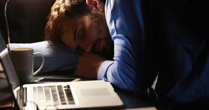 Businessman sleeping at his desk stock video footage