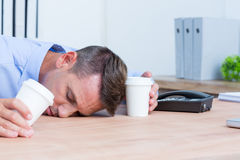Businessman sleeping on his desk Stock Photos
