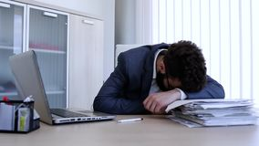 Businessman sleeping on his work desk during the working time. Businessman sleeping on his work desk stock video footage