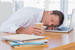Businessman sleeping on a laptop Stock Photo