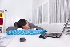 Businessman sleeping at the office Stock Image