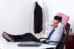 Businessman sleeping at the office Stock Photos