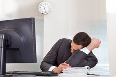Businessman sleeping at the office. Successful businessman sleeping at desk it the office Stock Photo