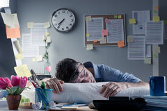 Businessman sleeping in the office overnight Royalty Free Stock Photos