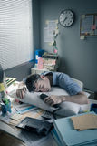 Businessman sleeping in the office overnight Stock Photos
