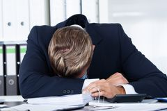 Businessman sleeping in office. Portrait Of Stressed Businessman Sleeping In Office Royalty Free Stock Photography