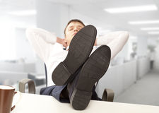 Businessman sleeping at the office Stock Images