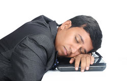 Businessman Sleeping over the laptop Royalty Free Stock Images