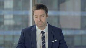 Businessman Sleeping While Sitting at Work