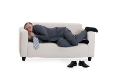 Businessman sleeping on a sofa Stock Photo