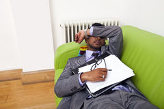 Businessman sleeping on a sofa Stock Images