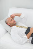 Businessman sleeping on sofa with digital tablet at home Royalty Free Stock Photography