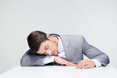 Businessman sleeping on the table Stock Photography