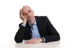 Businessman sleeping at work Stock Images