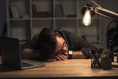 Businessman sleeping at workplace Royalty Free Stock Image