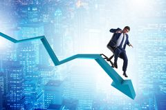 The businessman sliding down on chair in economic crisis concept. Businessman sliding down on chair in economic crisis concept Stock Image