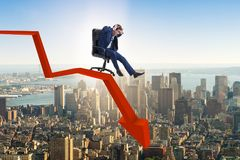 The businessman sliding down on chair in economic crisis concept. Businessman sliding down on chair in economic crisis concept Stock Photo