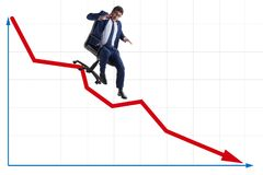 The businessman sliding down on chair in economic crisis concept stock images