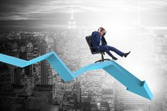 The businessman sliding down on chair in economic crisis concept royalty free stock images
