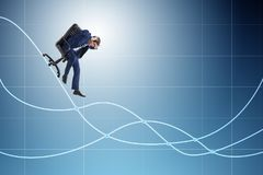 The businessman sliding down on chair in economic crisis concept. Businessman sliding down on chair in economic crisis concept Royalty Free Stock Images