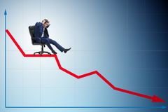 The businessman sliding down on chair in economic crisis concept stock image