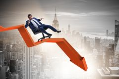 The businessman sliding down on chair in economic crisis concept. Businessman sliding down on chair in economic crisis concept Stock Photography