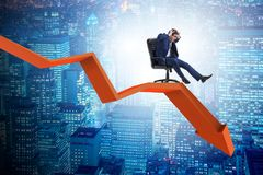 The businessman sliding down on chair in economic crisis concept. Businessman sliding down on chair in economic crisis concept Royalty Free Stock Image