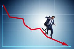 The businessman sliding down on chair in economic crisis concept. Businessman sliding down on chair in economic crisis concept Royalty Free Stock Photo