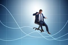 The businessman sliding down on chair in economic crisis concept stock photo