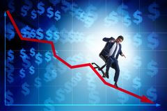 The businessman sliding down on chair in economic crisis concept stock photography