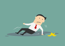 Businessman slipped on a banana Royalty Free Stock Photography
