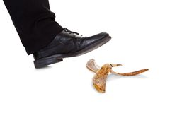 Businessman slipping on banana peel Royalty Free Stock Images