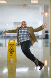 Businessman Slipping on Wet Floor Royalty Free Stock Photography