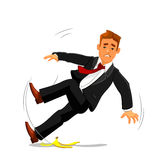 Businessman slips on banana peel and falls Royalty Free Stock Photo