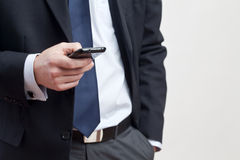 Businessman with smart phone Stock Photography