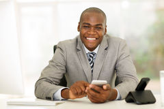 Businessman smart phone office Stock Photo