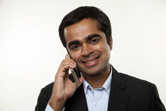 Businessman with smart phone in studio Royalty Free Stock Image
