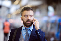 Businessman with smart phone Royalty Free Stock Photos