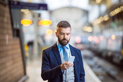 Businessman with smart phone Royalty Free Stock Photo