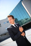 Businessman in smart suit walking outdoors Royalty Free Stock Images