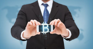Businessman with smartphone and bitcoin on screen Stock Images