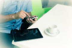 Businessman with smartphone during coffee break Stock Images