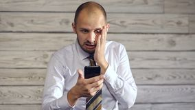 Businessman with smartphone enjoys good news stock video