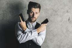 Businessman with smartphone guns Royalty Free Stock Images