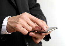 Businessman, smartphone Royalty Free Stock Image